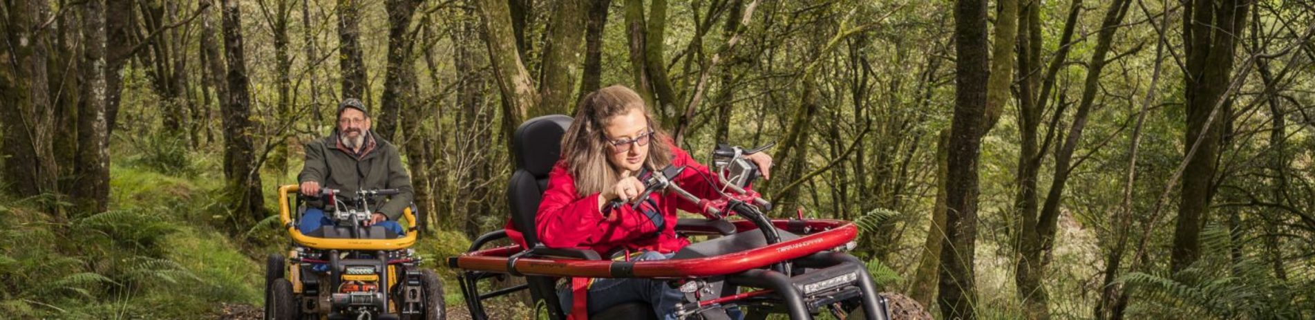 man-and-woman-on-mobility-scooters-in-bracklinn-forest