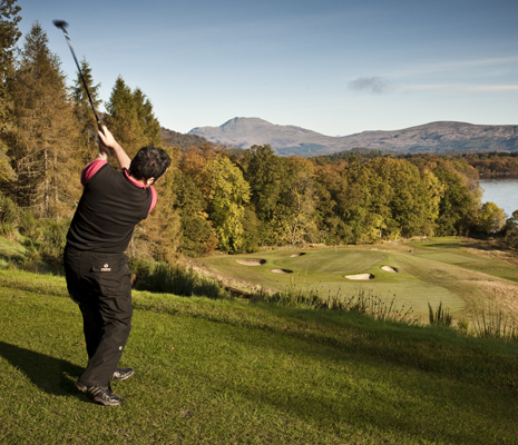 man-playing-golf-loch-lomond-and-ben-lomond-visible-in-the-distance