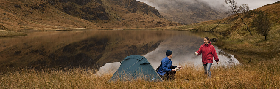 two-people-wild-camping-beside-loch