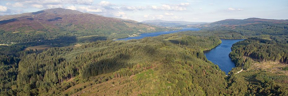 aerial-view-of-achray-forest-and-trossachs-hills-with-loch-venachar-and-loch-drunkie-prominent