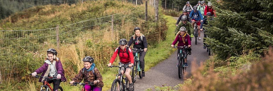 group-of-young-people-cycling-on-national-cycle-route-seven-in-glen-ogle