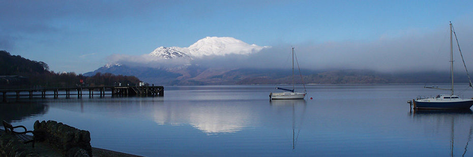 loch-lomond-in-foreground-with-small-boat-on-the-water-and-snow-capped-ben-lomond-in-the-distance