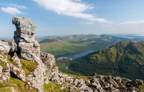 summit-of-cobbler-mountain-with-stunning-views-over-loch-lomond-and-surrounding-hills-and-with-the-needle-a-rock-chimney-prominent-on-left-of-picture