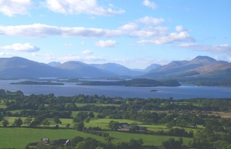 view-of-loch-lomond-islands-and-surrounding-hills-with-gartocharn-village-and-farmland-in-foreground-seen-from-dumpling-hill